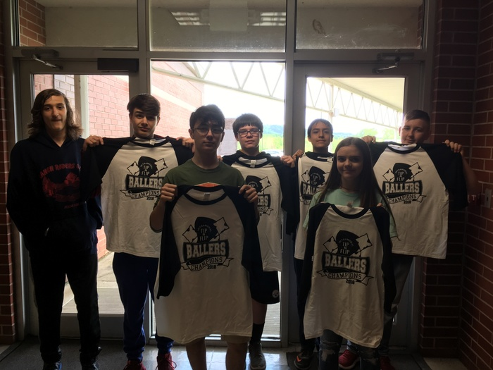 Tip- n-Flip winners pictured with their t-shirts