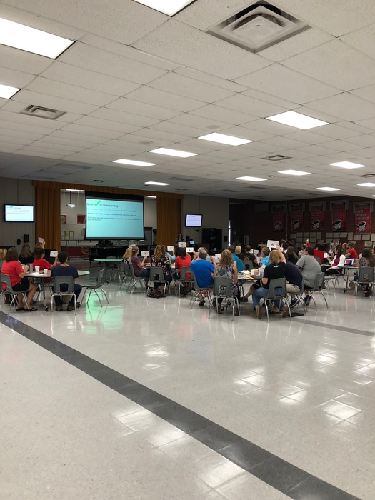 RJHS teachers in a meeting for back to school