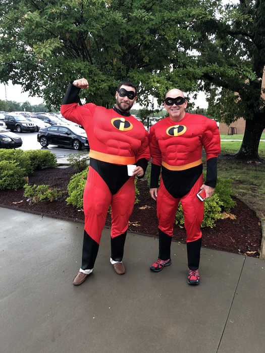 Coach Far and Michael Roys dressed up as super heroes