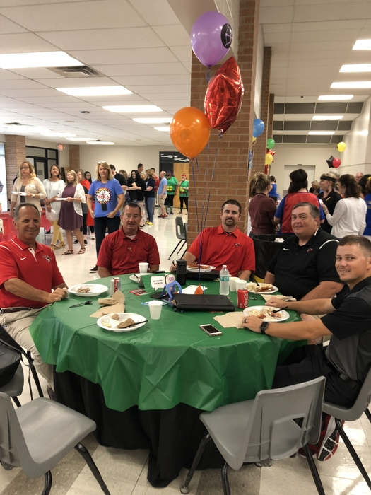 Coaches sitting at breakfast table