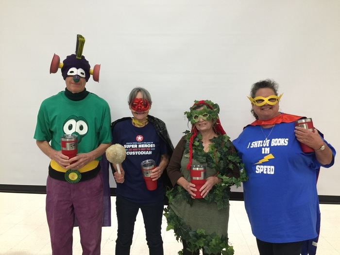 Classified staff dressed up as super heros at the Back to School Breakfast