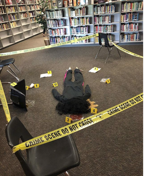 Coach White set up a crime scene in the library for his classes to investigate
