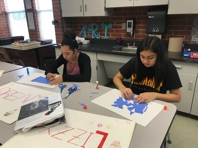 Students working at a table in art class.