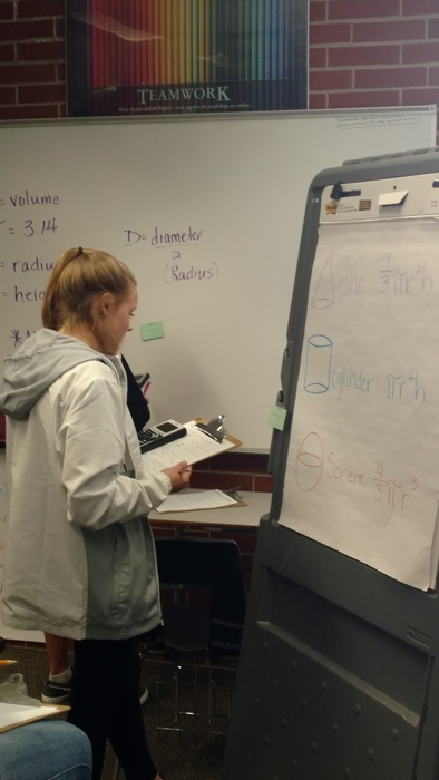 Student at an easel during math work.