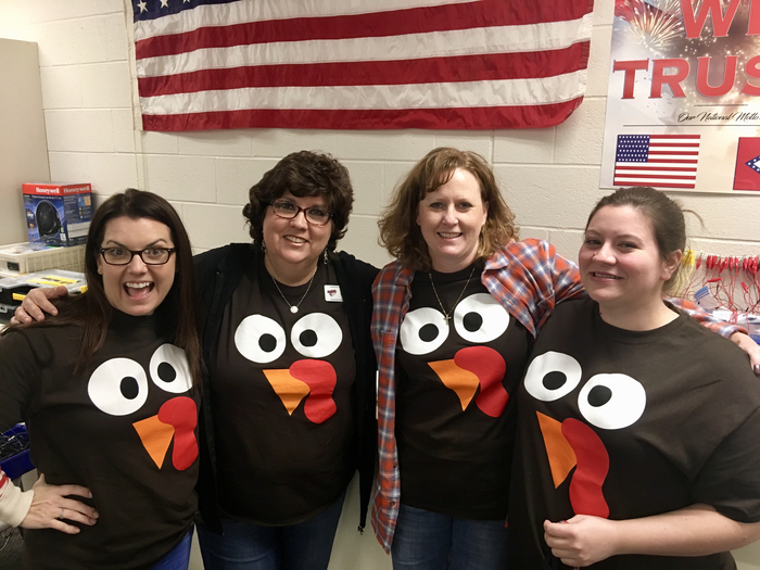 Teachers in their Thanksgiving T-shirts.