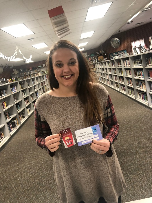 Haley Jackson posing with her gift card she won.