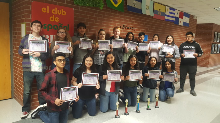 Spanish club posing and and holding their certificates for winning third place in Drama.