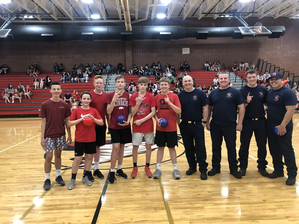Russellville Fire Department posing with the dodgeball winners.