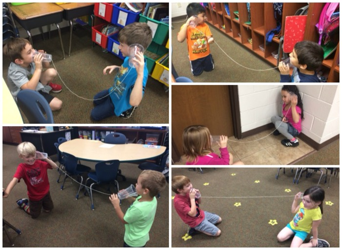 First Grade students using cups and string to feel the vibration of sounds.
