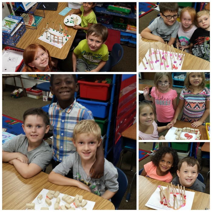 Kindergarten students with their pig houses made out of different materials.