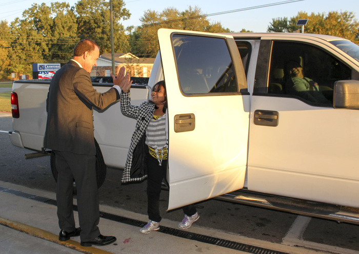 Dr. Gotcher gives a student a high five during morning drop off at Crawford Elementary.