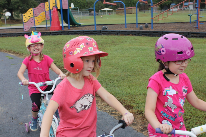 Students riding their bikes.