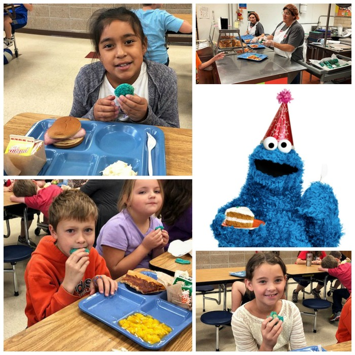 Picture of students eating blue cookies to celebrate cookie monster's birthday