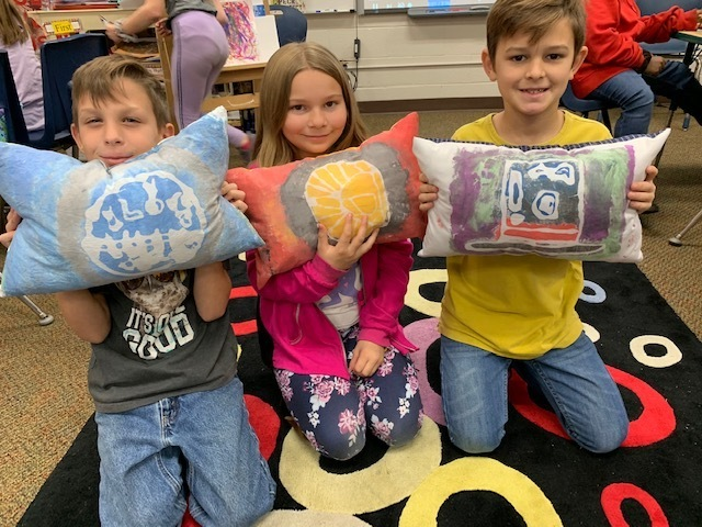 Students with pillows they created