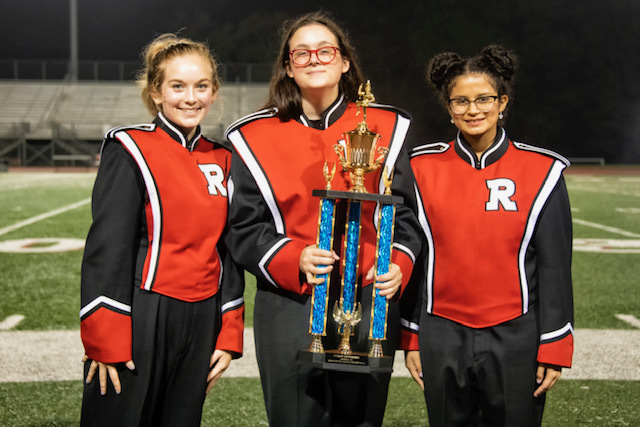 Band members holding trophy