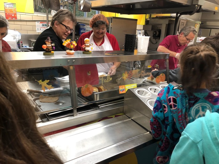 Picture of Dwight cafeteria workers serving Thanksgiving lunch to students