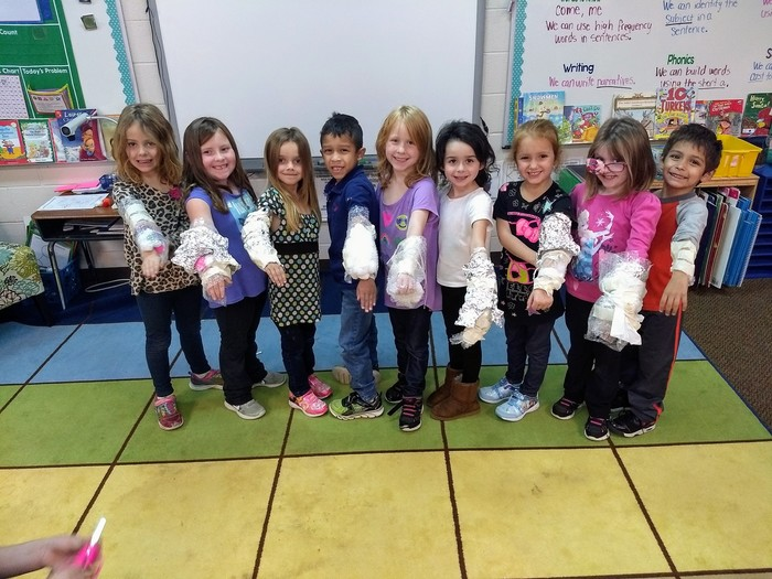 Mrs. Wortham's Kindergarten Class showing off their casts