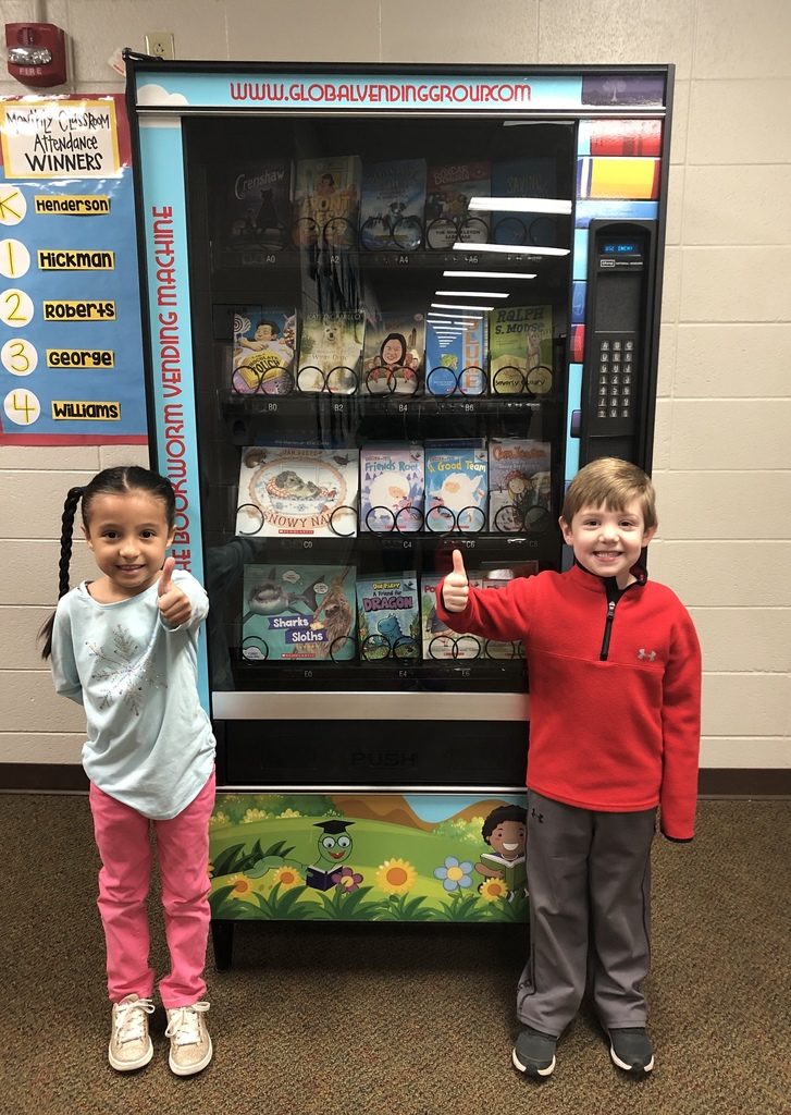kids with bookworm vending machine