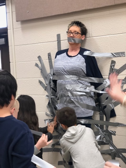 Mrs. Donna taped to the wall