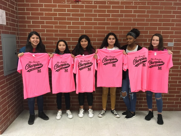 Picture of winning nitroball team; girls pictured holding their winning t-shirts