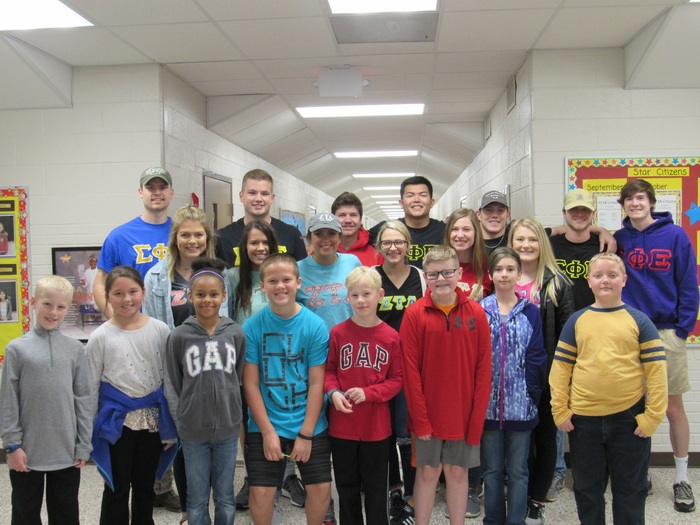 Picture of ATU students with Dwight kids