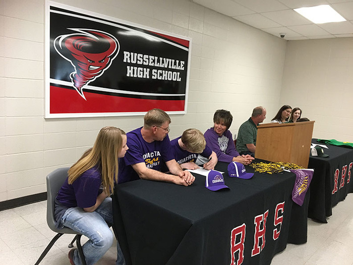 RHS Seniors Bryson George and Logan Sloss signing.