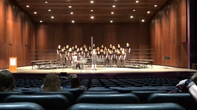 RJHS Girls Choir on stage performing