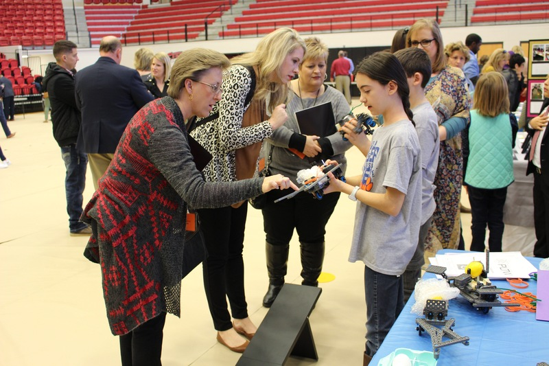 Students demonstrate their project at the PLTW Showcase in Cyclone Arena