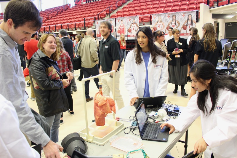 Biomedical students demonstrate their project at the PLTW Showcase in Cyclone Arena